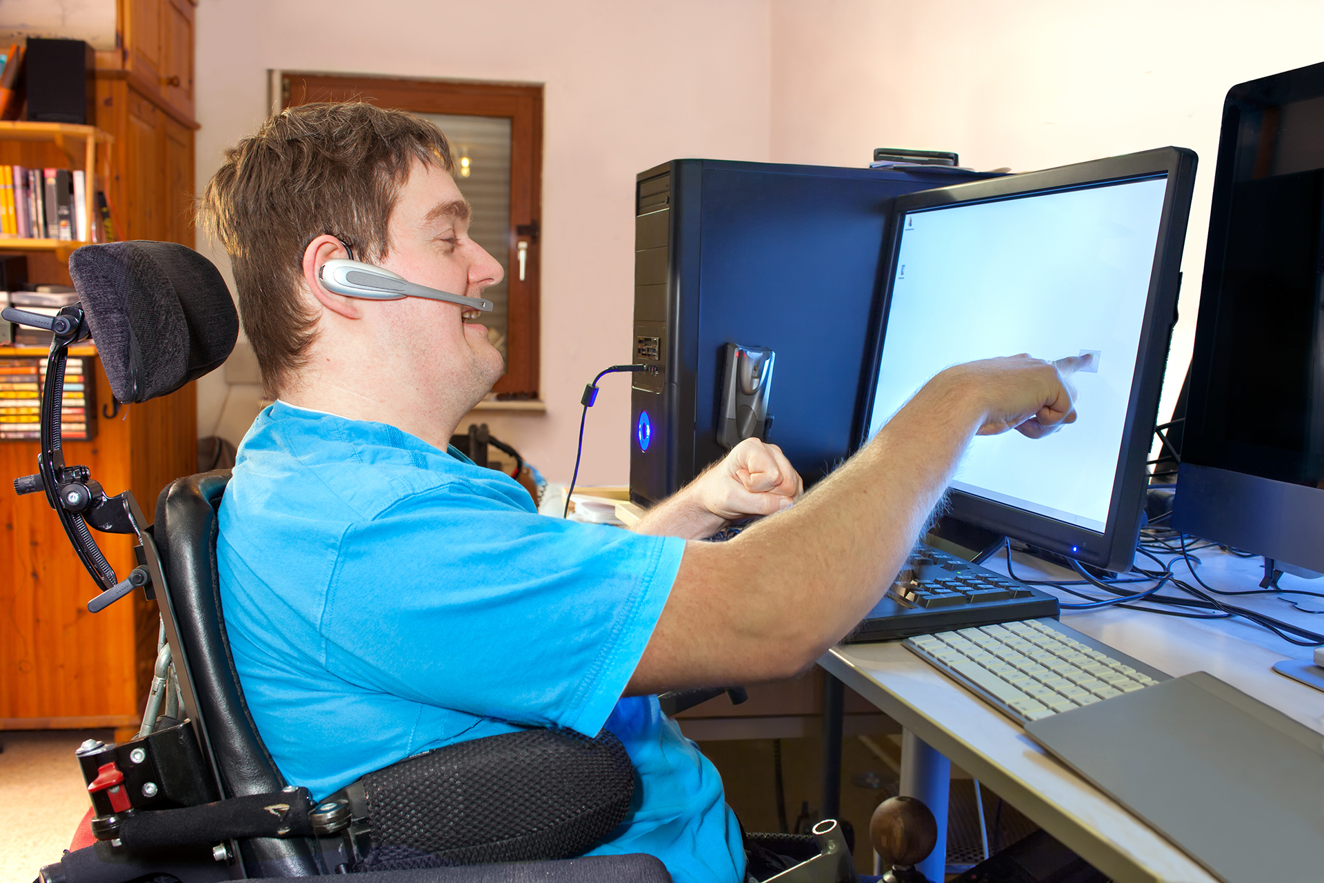 Student in wheelchair using assistive technology